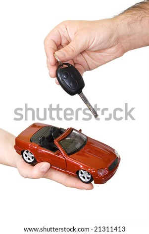 Woman and man hands with red sports car and key - isolated