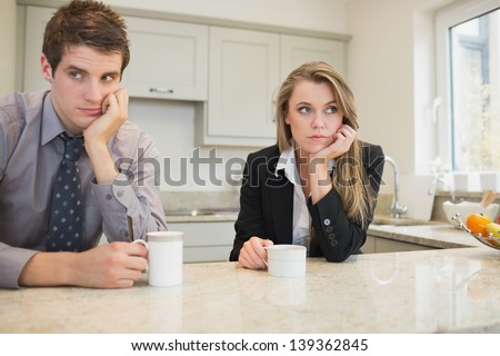 Woman and man having a dispute in kitchen - stock photo