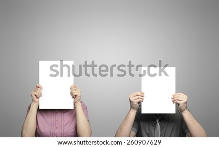 woman and man holding posters - stock photo