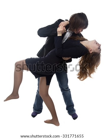 Woman and man in black jacket dancing. Isolated photo with white background.