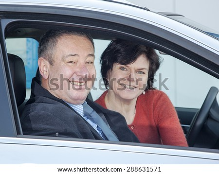 Woman and man in car - stock photo