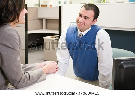 Woman and man in office - stock photo