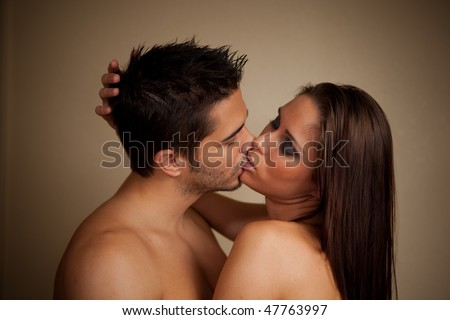 Woman and man kissing, both shirtless - stock photo