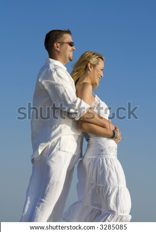 Woman and man looking ahead. Both wearing white clothes. - stock photo