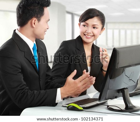 woman and man office worker meeting in the office - stock photo