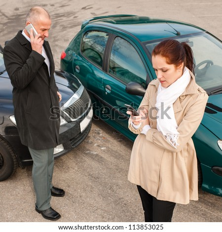 Woman and man on phone car crash accident calling problem - stock photo