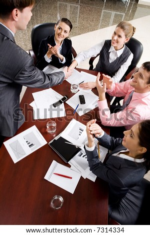 Woman and man shaking hands make agreement at conference - stock photo