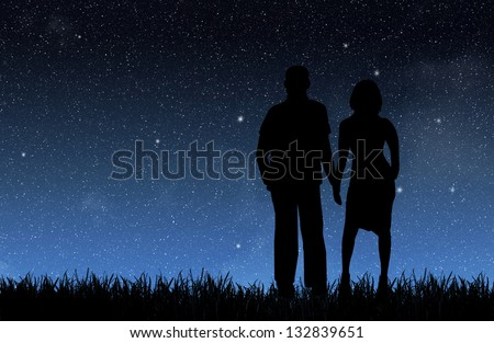 Woman and man under the night sky - stock photo