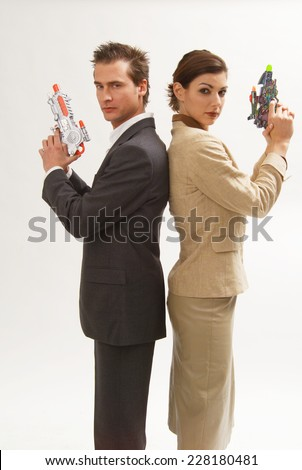 Woman and man with toy pistols - stock photo