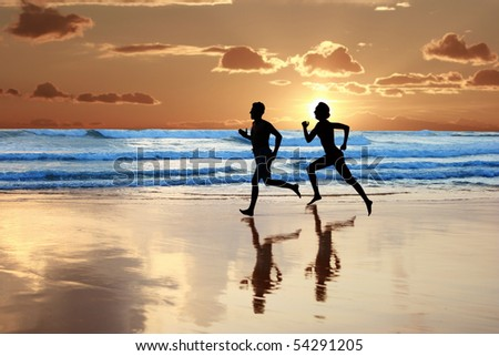 Woman and men running during sunset - stock photo