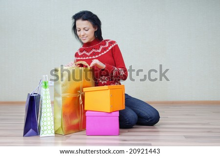 Woman and packages with procured gifts and presents - stock photo