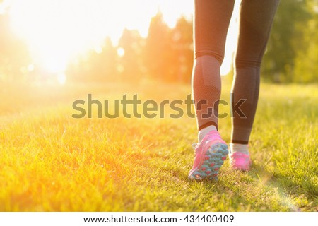 Woman and running shoes, exercising in nature