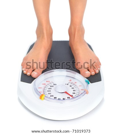 Woman and scales. Over white background - stock photo