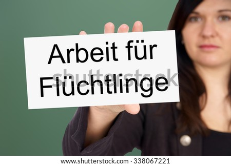 Woman and Sign with the german words Working for Refugees / Working for Refugees - stock photo