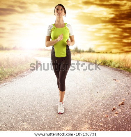 woman and sport on the road and sunset