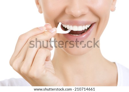 Woman and teeth floss (Toothpick) - Young caucasian woman flossing her teeth (close up woman smile) - stock photo