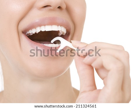 Woman and teeth floss (Toothpick) - Young caucasian woman flossing her teeth (close up woman smile)