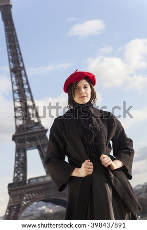 woman and the eiffel tower - stock photo