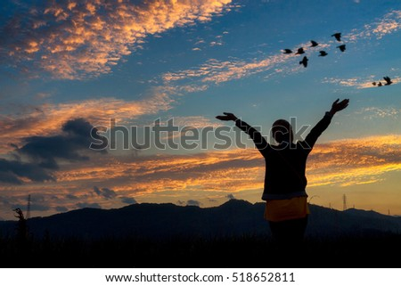 Woman and travel enjoying nature on sunset sky background.