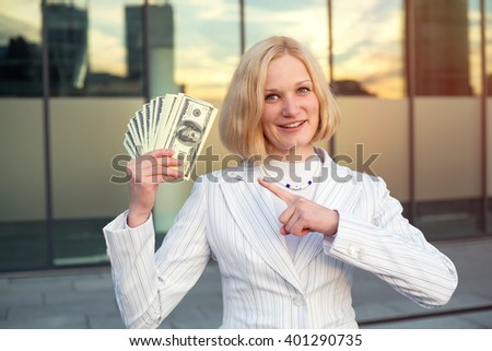 Woman and usa dollar money. Business woman holding money. Business woman holding a lot of hundred dollar. Business woman has earned a good amount of dollars. Win the lottery. - stock photo