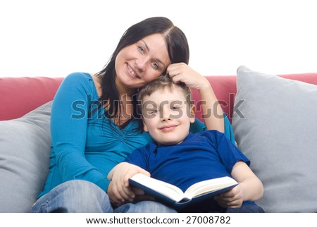 Woman and young boy reading book