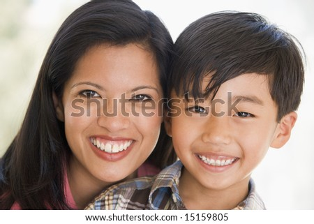 Woman and young boy smiling - stock photo