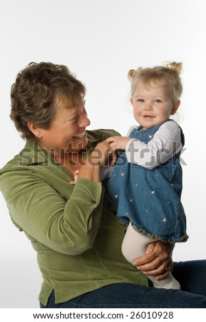 Woman and young child together on white background.