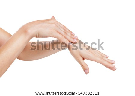 Woman applies cream on her hands isolated on white background - stock photo
