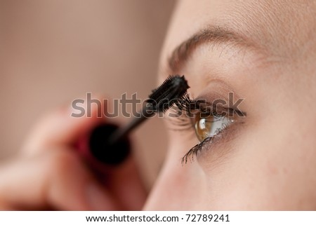 woman applying colorful makeup - stock photo