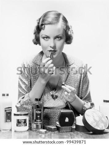Woman applying cosmetics - stock photo