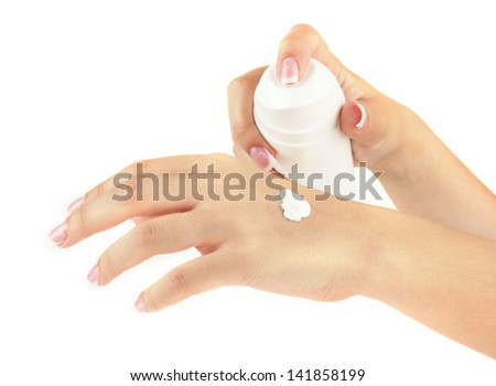 Woman applying cream on hands, isolated  on white