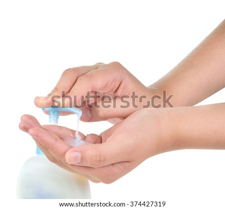 woman applying cream on hands on white background