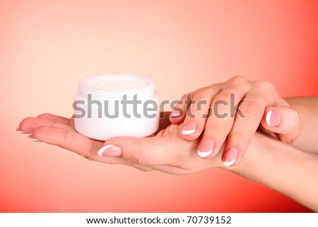 Woman applying cream on her hand - stock photo