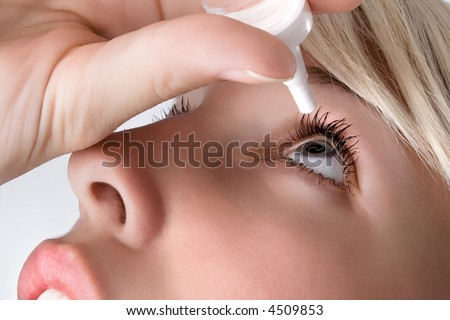 woman applying eyedroppers, close up - stock photo