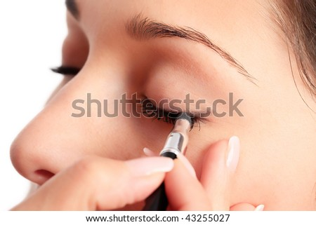 Woman applying eyeshadow makeup - stock photo