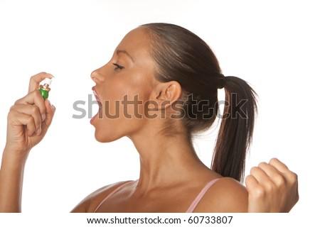 woman applying Fresh breath spray - stock photo