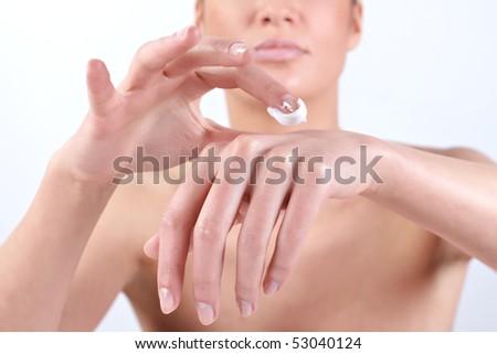 Woman applying hand cream. - stock photo