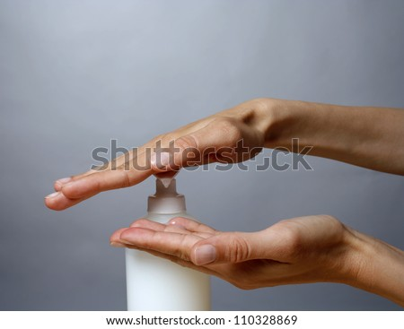 Woman applying liquid soap - stock photo