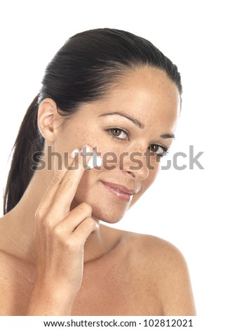 Woman Applying Moisturizer Cream - stock photo