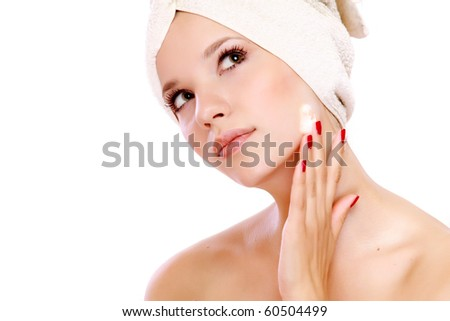 Woman applying moisturizer cream on face - stock photo