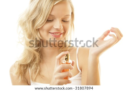 Woman applying perfume on her wrist isolated on white background - stock photo
