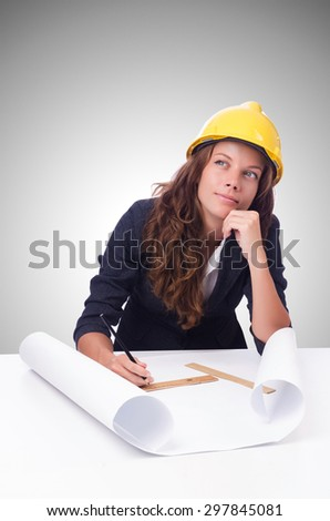 Woman architect with drawings against gradient  - stock photo