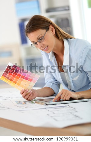 Woman architect working in office on project