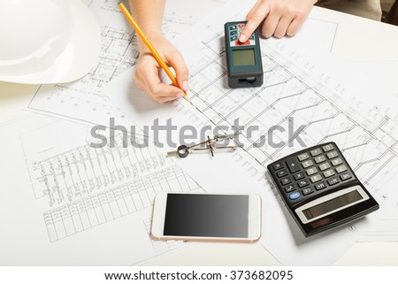 Woman architector at work drawing blueprint