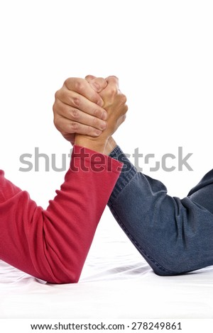 Woman Arm Wrestling Against A Man/ Woman Versus Man Isolated - stock photo
