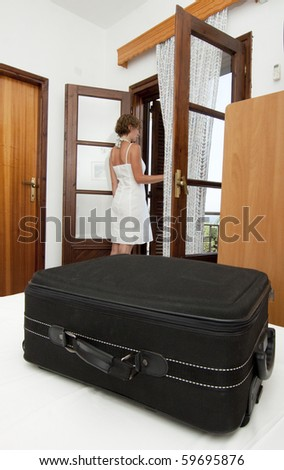 Woman arriving in simple pension bedroom