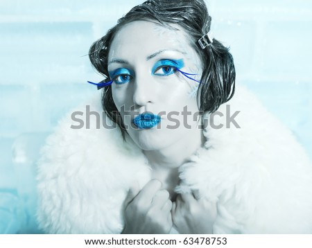 Woman as a snow queen in ice room - stock photo