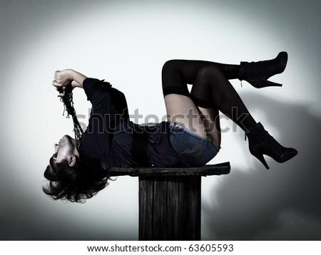 Woman as a vampire. Halloween face art - stock photo