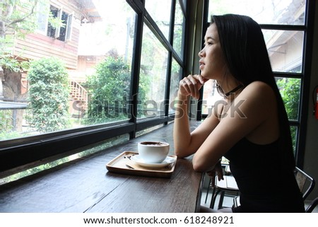Woman Asian having coffee time in coffee shop cafe. seletive focus and nois over withe Fhoto.