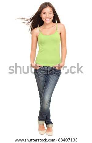 Woman. Asian woman model standing happy and smiling. Fresh portrait of a young beautiful mixed race Caucasian / Asian female model in full length isolated on white background. - stock photo